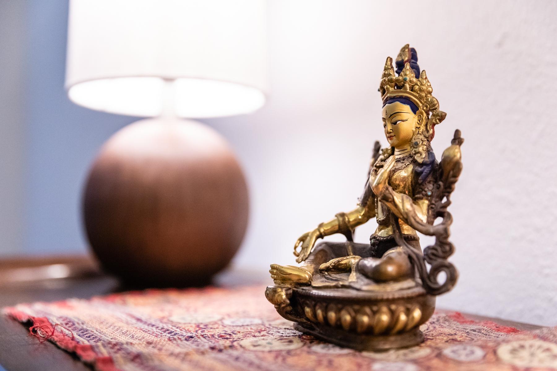 Tara statue in the office of Crimson Lotus Healing Arts